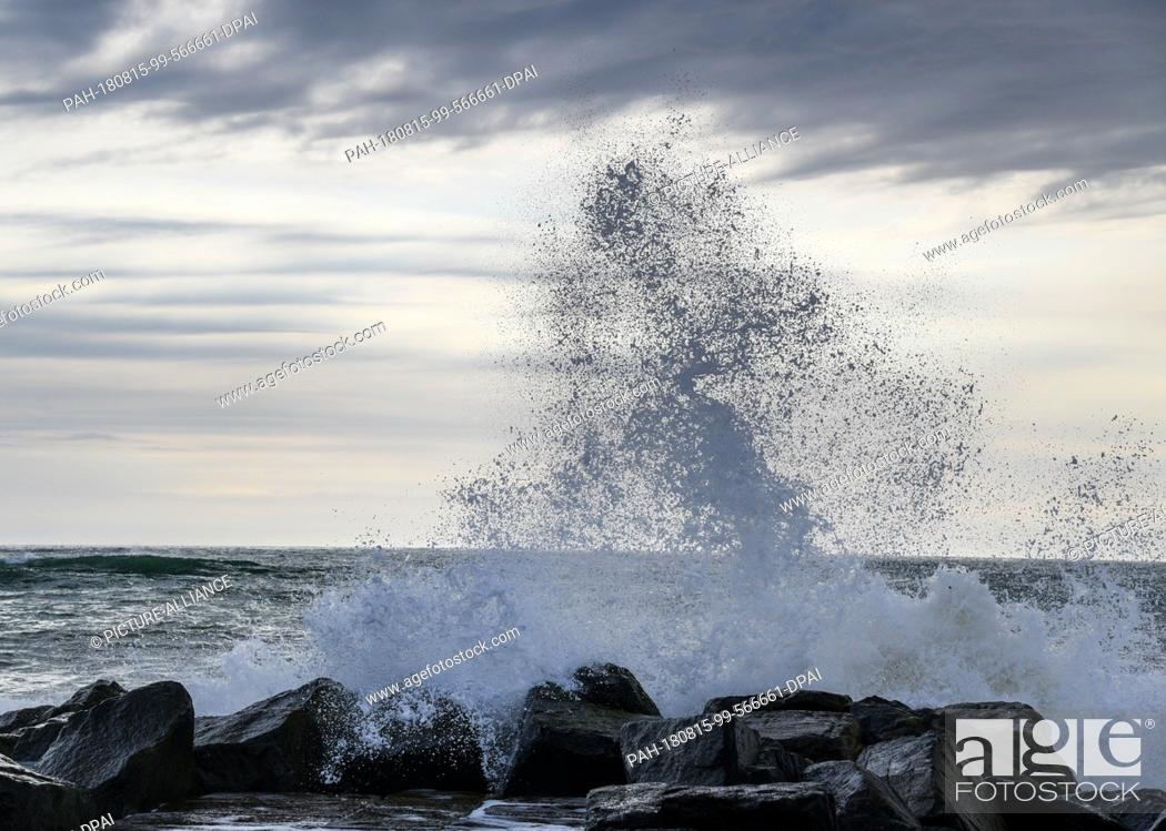 Stock Photo: 29 July 2018, Denmark, Ferring: Water of the North Sea splashes up at a coastal protection wall. · NO WIRE SERVICE · Photo: Patrick Pleul/dpa-Zentralbild/ZB.