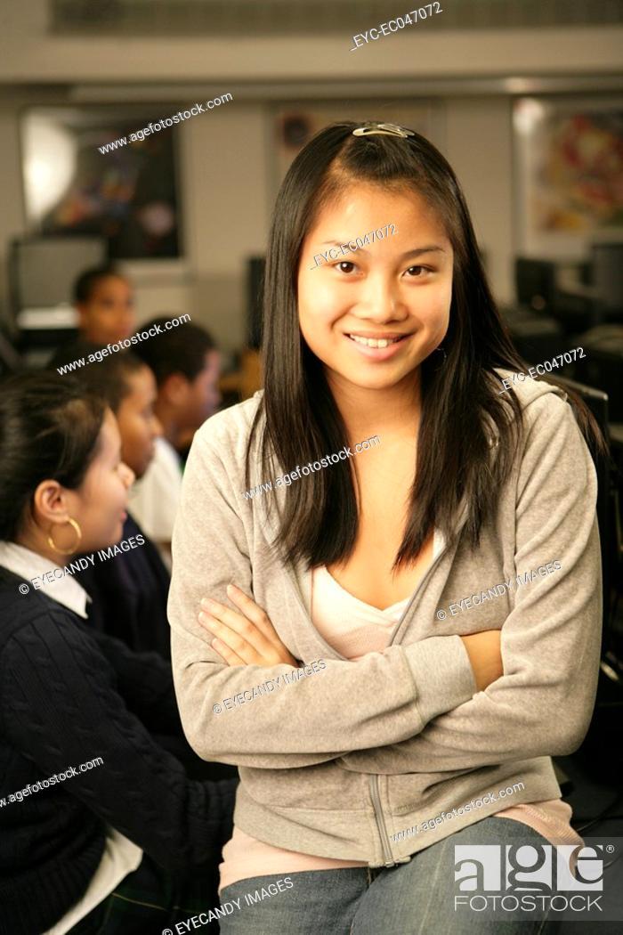 Stock Photo: Teenage girl 15-17 sitting in classroom, portrait.