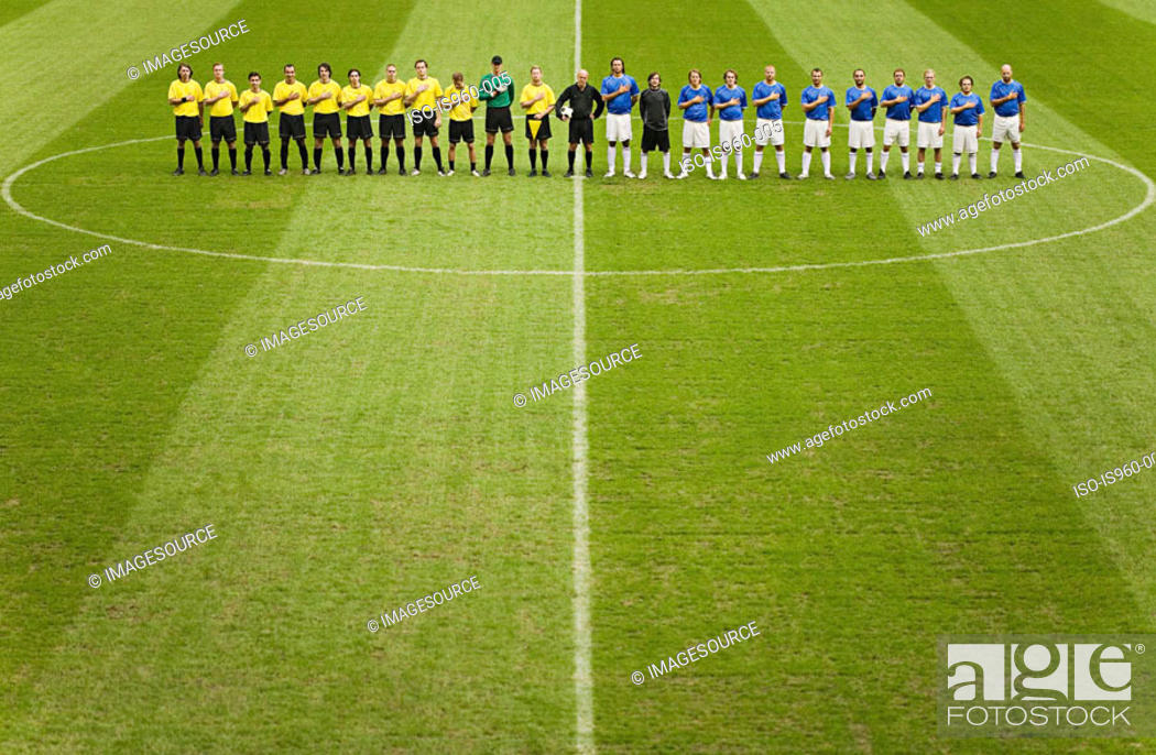 Stock Photo: Football teams on the pitch.