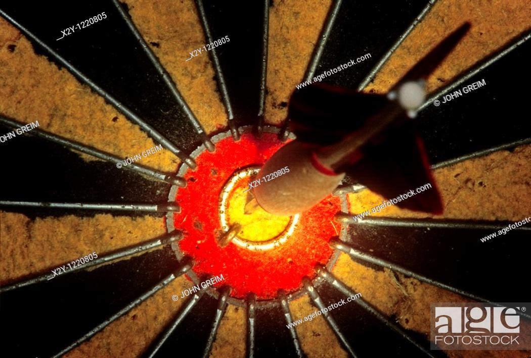 Stock Photo: Dart in bulls eye.
