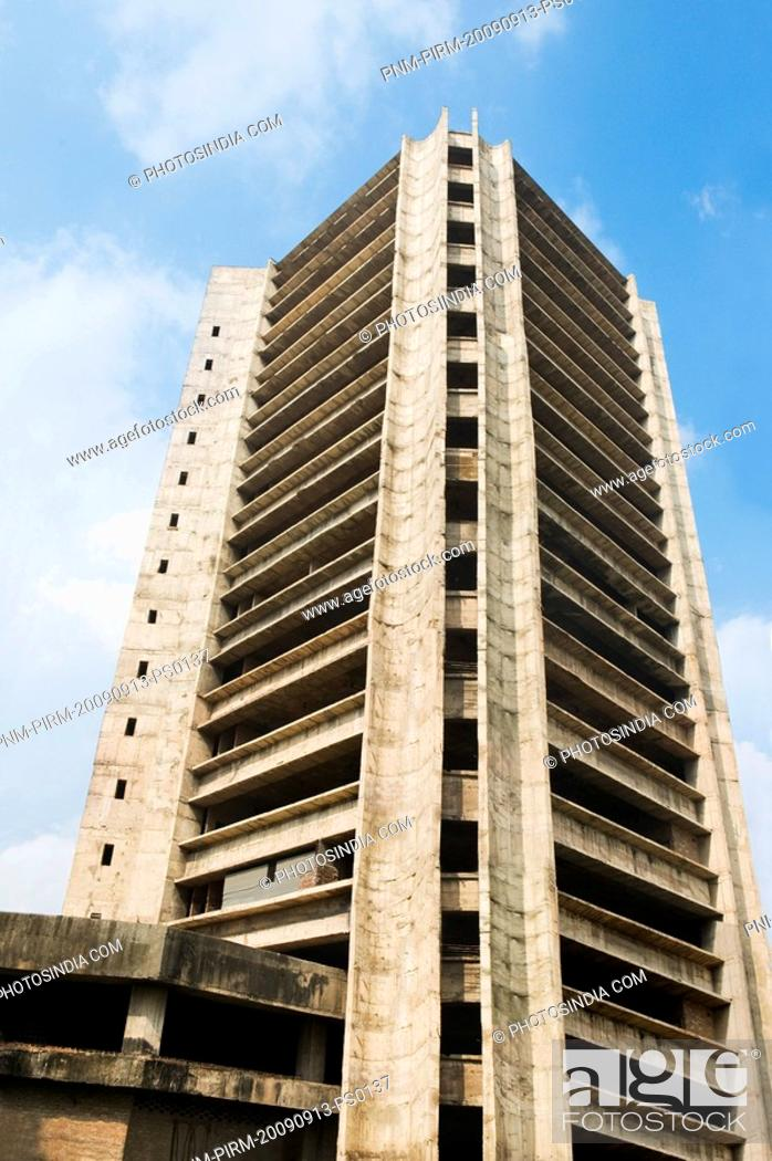 Stock Photo: Low angle view of a building under construction, Barakhamba Road, New Delhi, India.