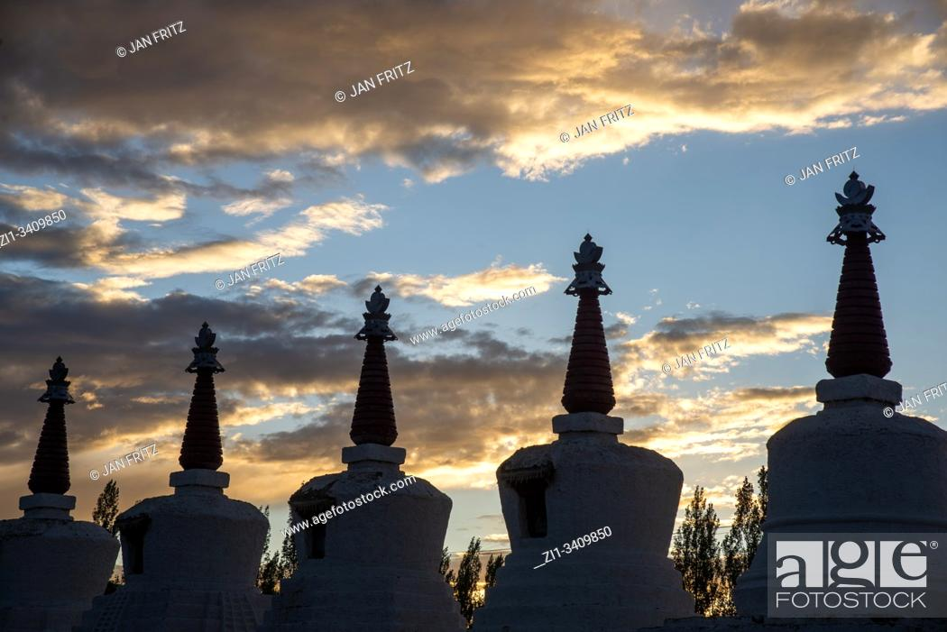 Stock Photo: silhouettes of stupas at Thiksey monastery in Ladakh, India.