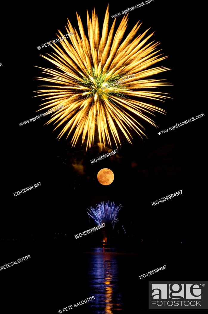 Stock Photo: Firework in the sky above the moon.