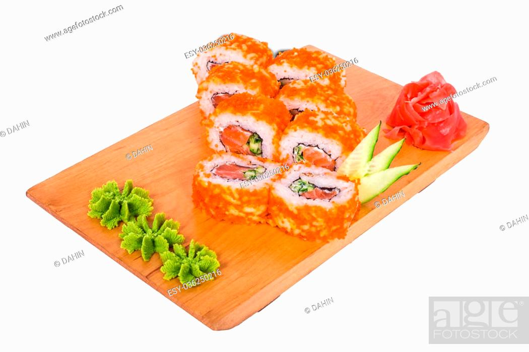 Imagen: 6 delicious sushi with red caviar and wasabi on a wooden tray.