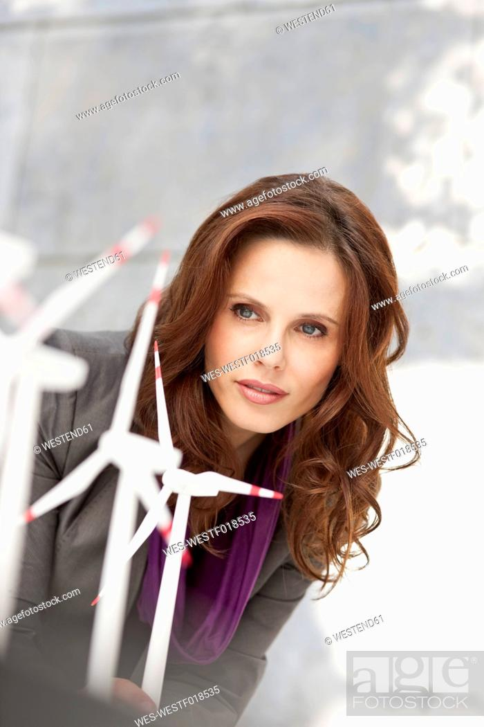 Stock Photo: Germany, Leipzig, Businesswoman looking at wind power model.
