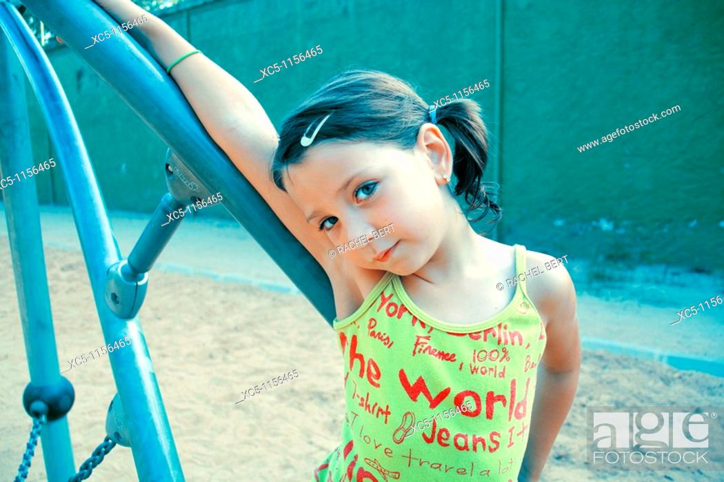 Stock Photo: 7 years old girl on the playground.