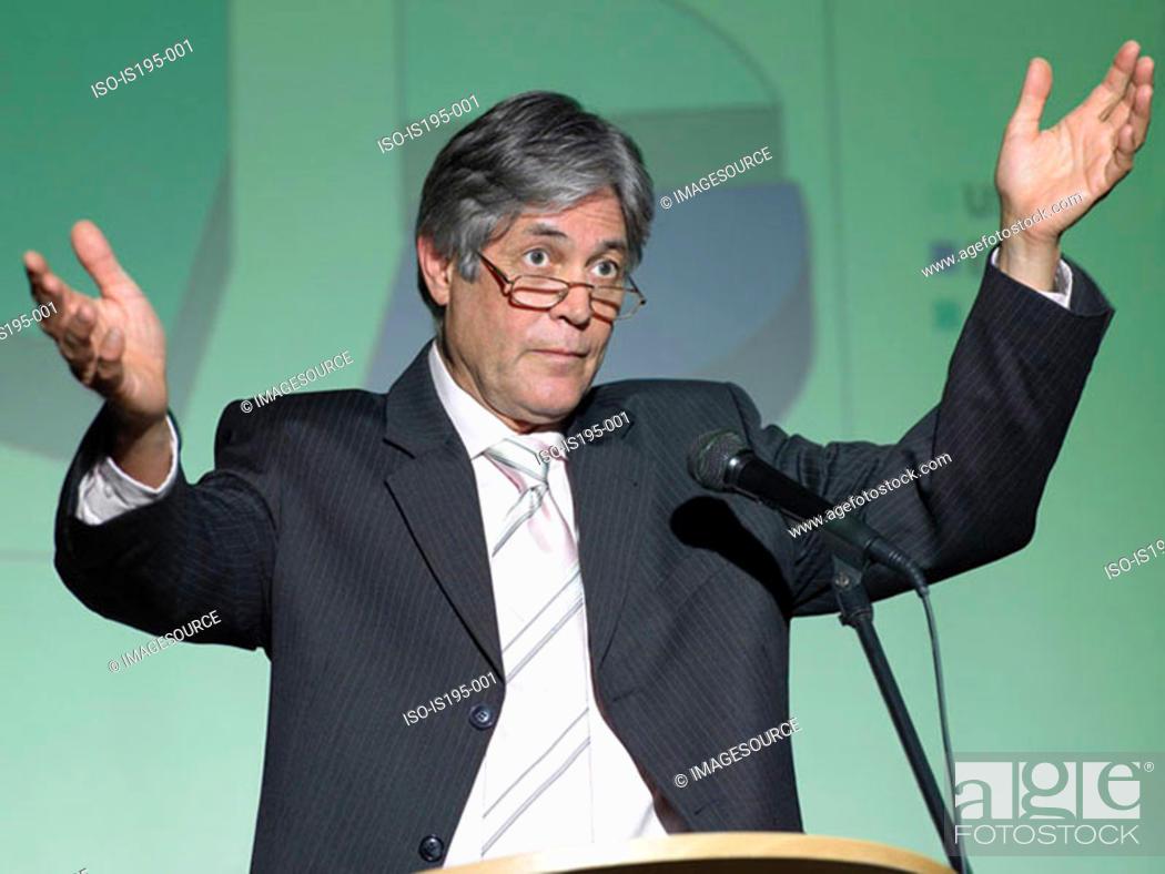 Stock Photo: Businessman giving a speech.