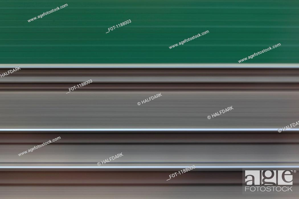 Stock Photo: Railroad tracks viewed in abstract blurred motion from moving train.
