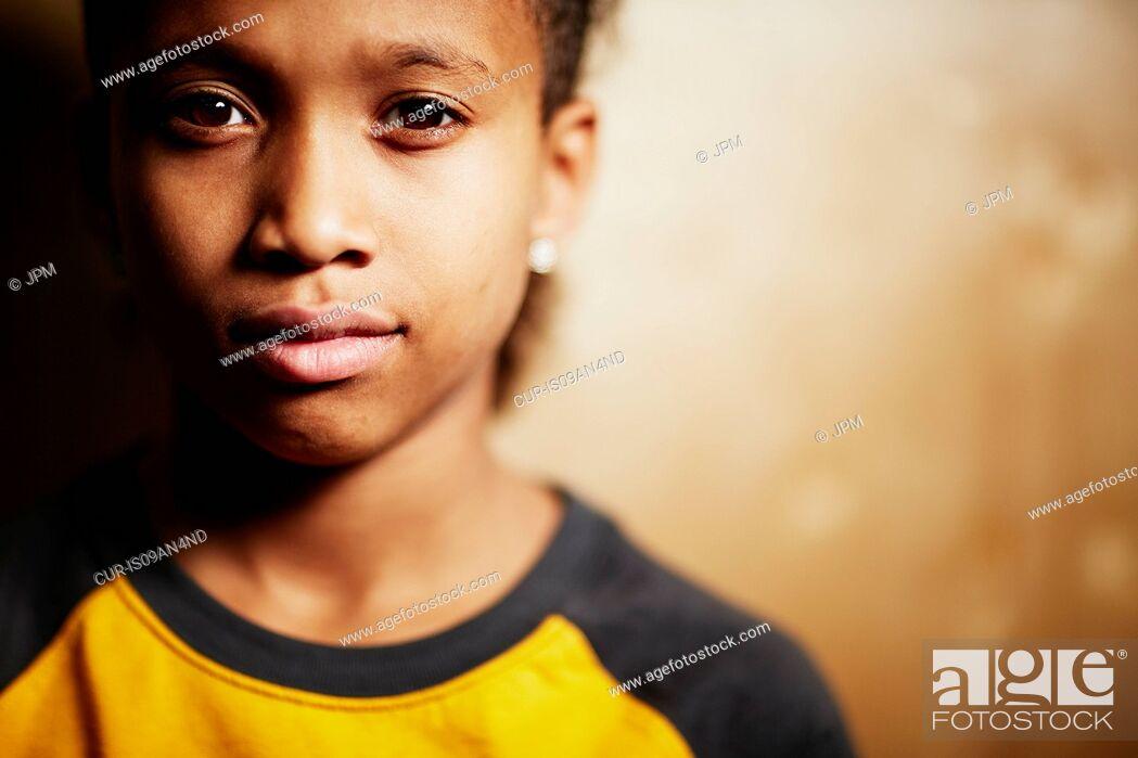 Stock Photo: Boy looking at camera.