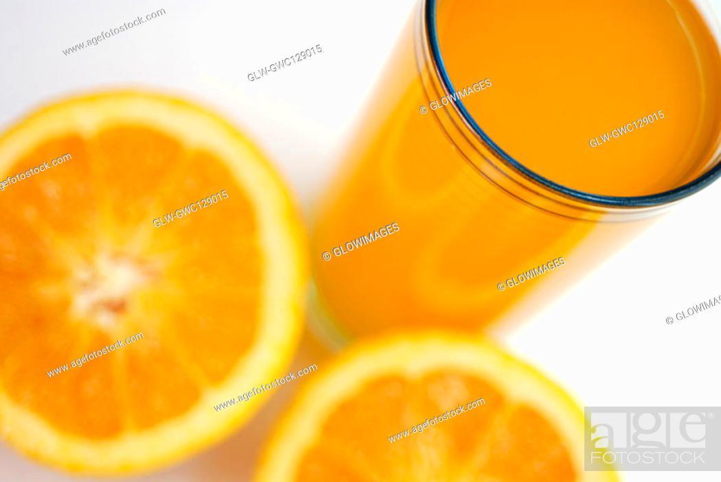 Stock Photo: High angle view of orange juice with orange slices.