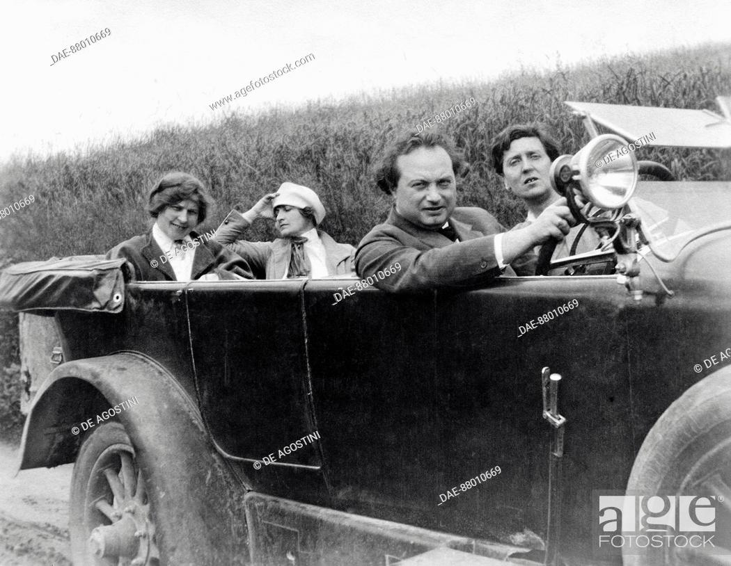Stock Photo: Helene Berg, Alma Mahler, Franz Werfel (1890-1945) and Alban Berg (1885-1935) photographed in a car.  Vienna, Alban Berg Stiftung.