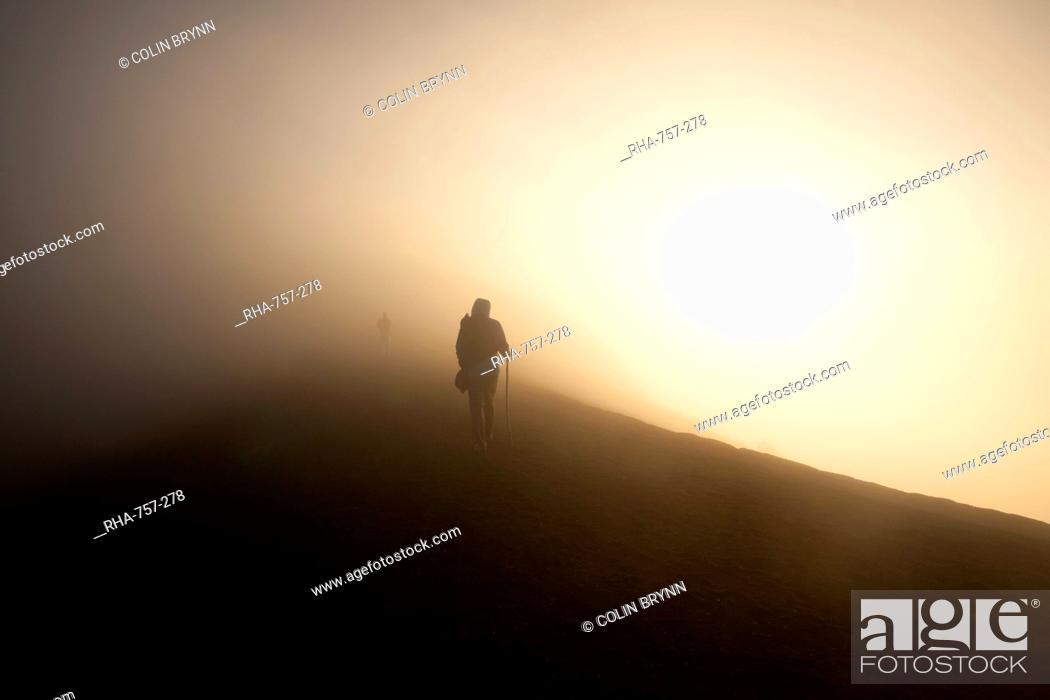 Stock Photo: Woman walking on the summit of Volcan Acatenango, Guatemala, Central America.