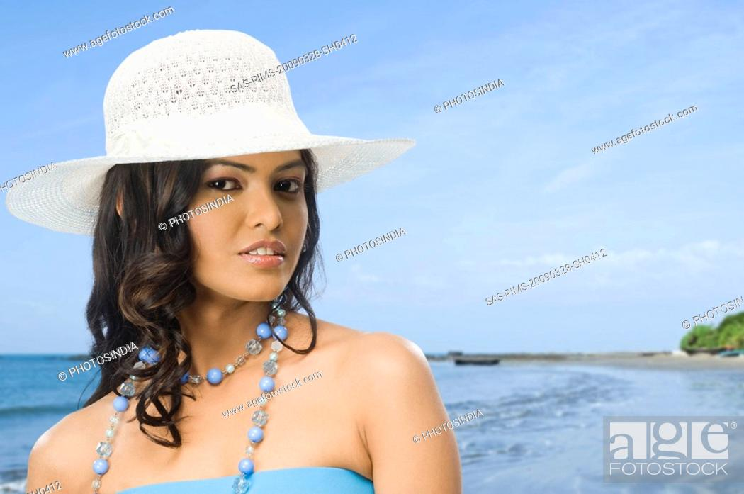 Stock Photo: Portrait of a female fashion model posing on the beach.