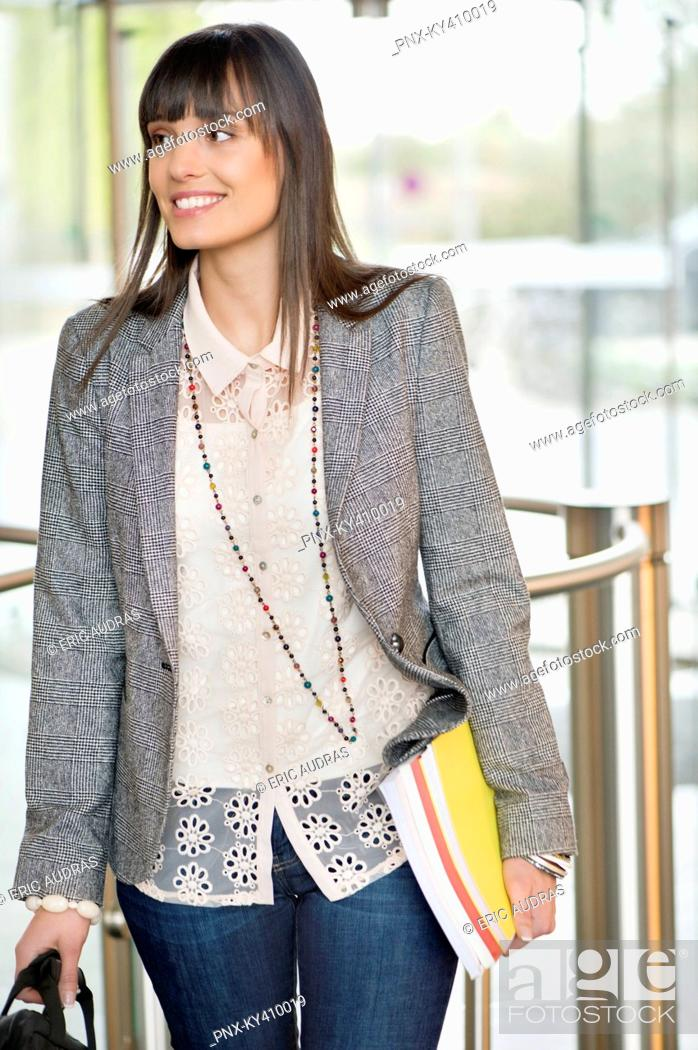 Stock Photo: Businesswoman entering in an office lobby.