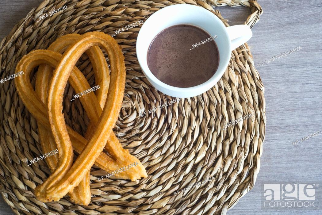 Stock Photo: Churros with a cup of chocolate.