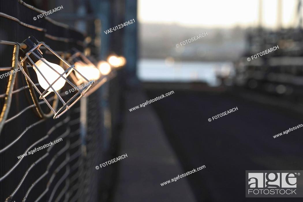 Stock Photo: dark, gloomy, lit, lights, street, outdoors.