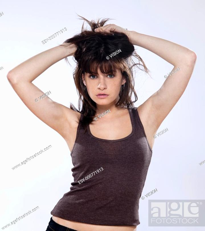 Stock Photo: portrait on isolated grey background of a beautiful young caucasian woman in studio.