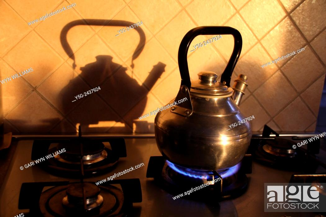 Stock Photo: kettle on gas stove in kitchen.