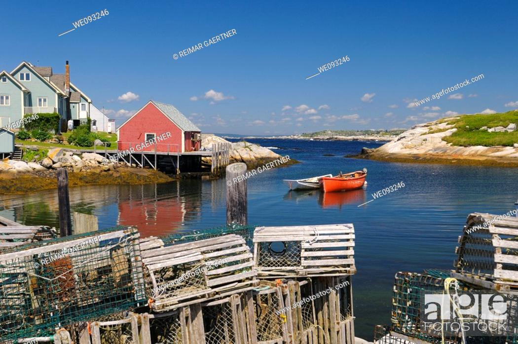 Stock Photo: Lobster traps on the wharf in the quiet fishing village of Peggys Cove Nova Scotia.