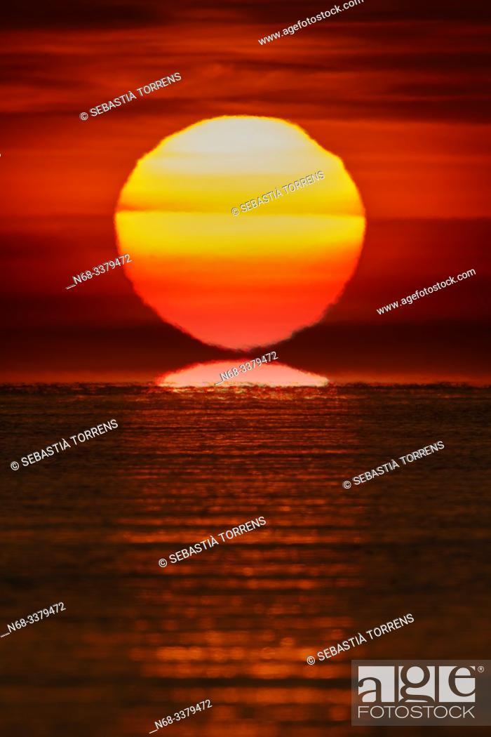 Stock Photo: Sunrise and reflections on the sea at Pollença Bay, Majorca, Spain.