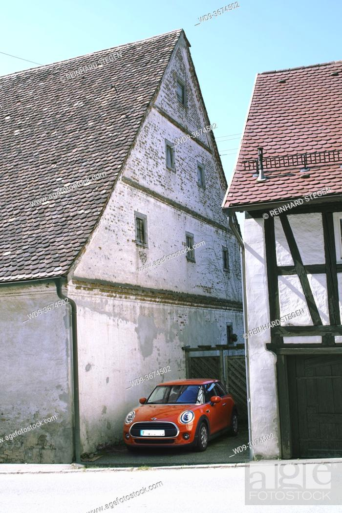 Stock Photo: design sculpture in contrast traditional house and car.