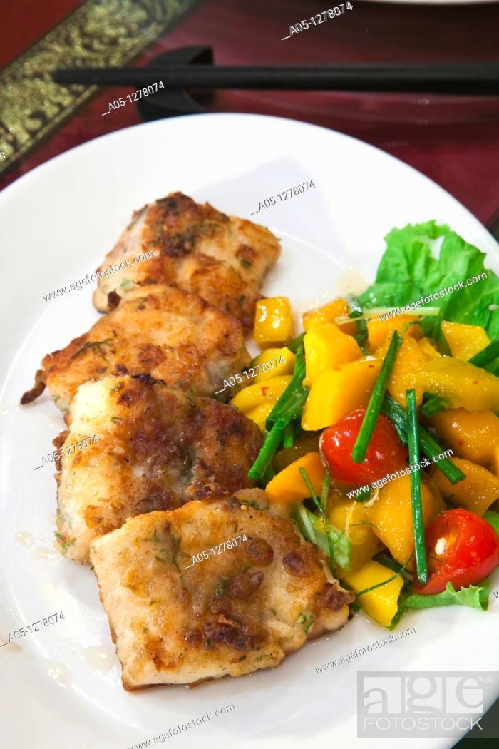 Stock Photo: Pan fried Nha Trang sea bass with mango salad  Wild Lotus Restaurant  Hanoi  Vietnam.