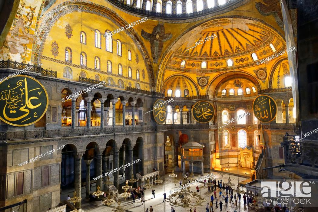Stock Photo: Golden Apse or Qiblah wall inside the Hagia Sophia with wood pendants and Seraphim face.