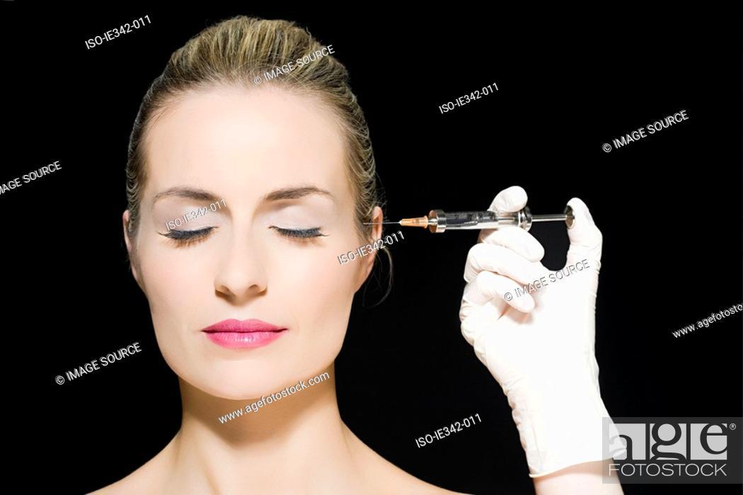 Stock Photo: Woman having neurotoxin injection.