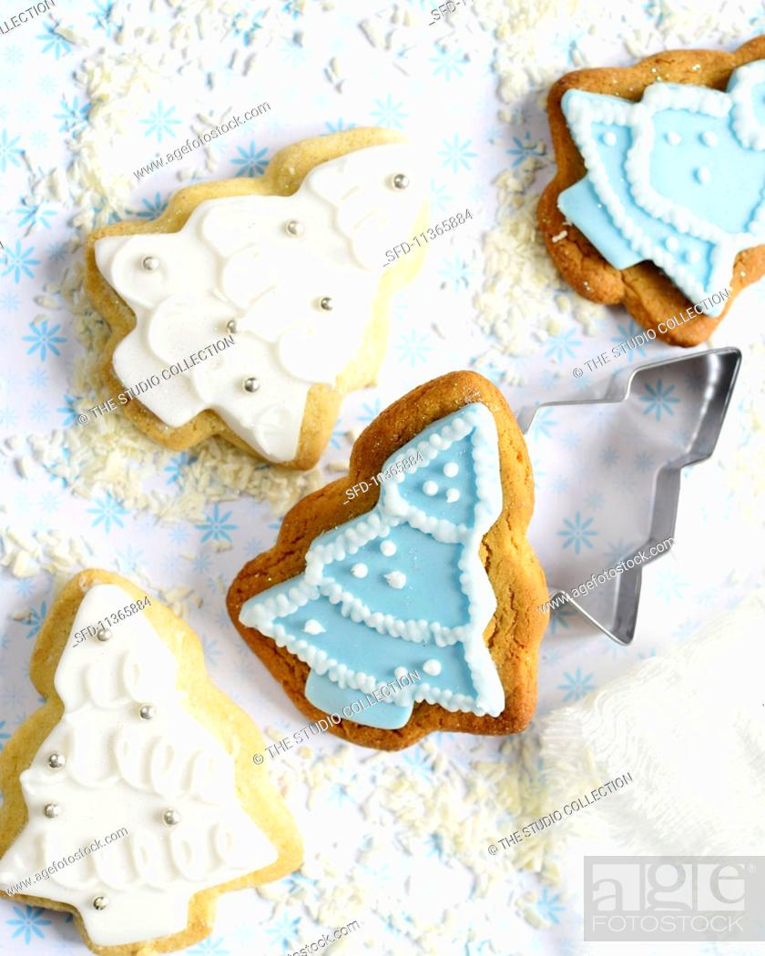 Christmas Tree Shaped Gingerbread And Shortbread Biscuits With Blue