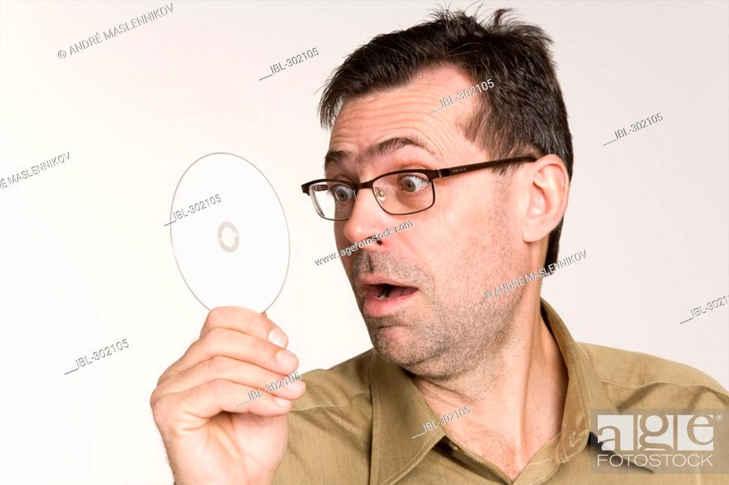 Stock Photo: Man with CD.