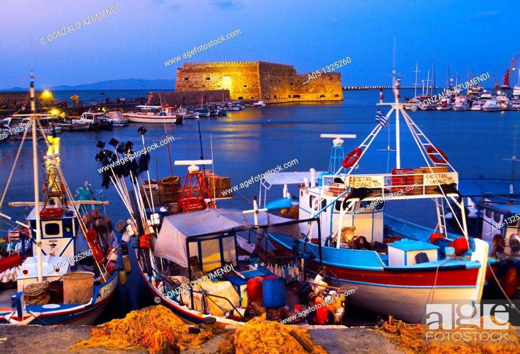 Stock Photo: Cretan boat moored Heraklion harbour and Venetian fortress Koules Castle, Iraklio, Crete, Greece.