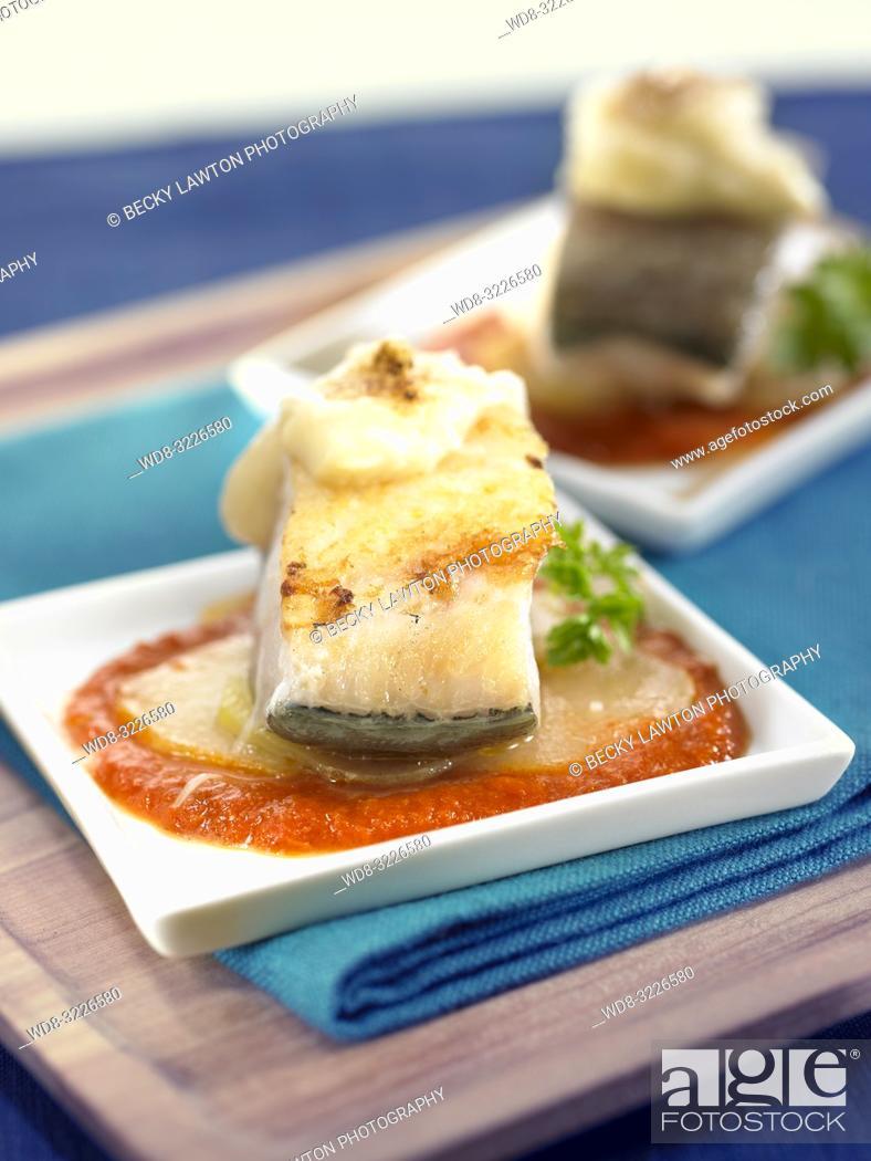Stock Photo: cazuelita de bacalao con cebolla y patatas / cod with onion and potatoes.