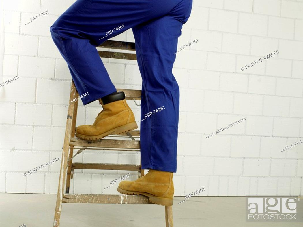 Stock Photo: Man on a ladder, lower body.