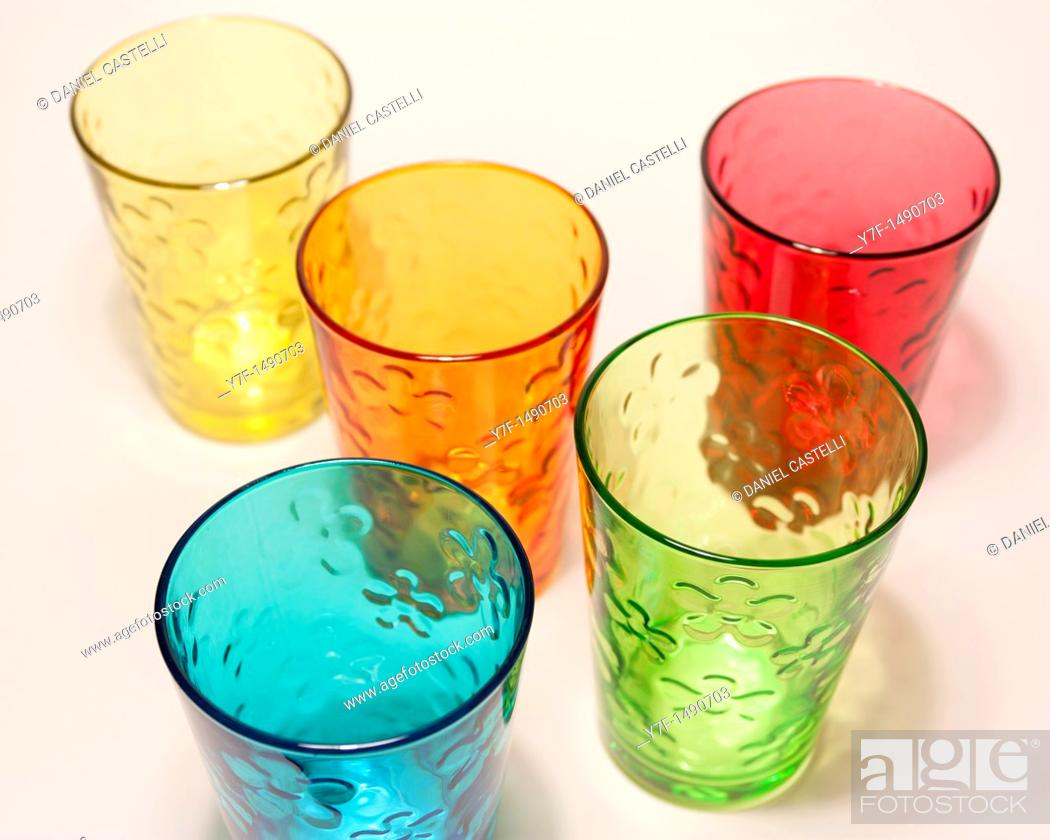 Stock Photo: Five color glasses on white table.