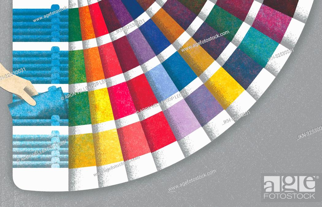 Imagen: Hand choosing from fanned out color sample.