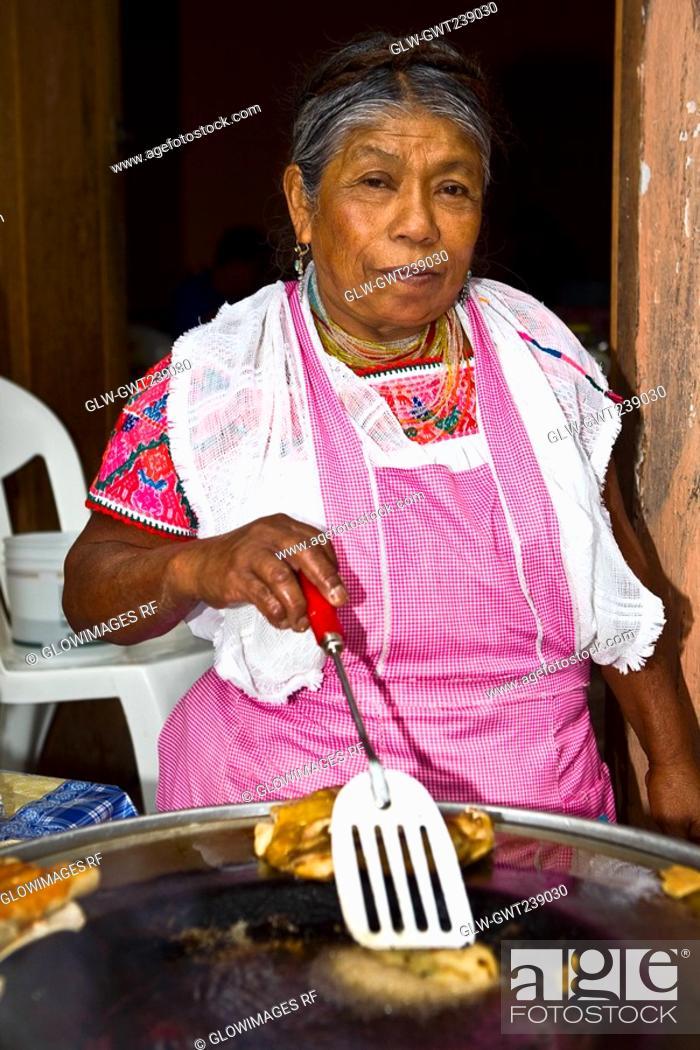 Stock Photo: Portrait of a senior woman cooking, Cuetzalan, Puebla State, Mexico.