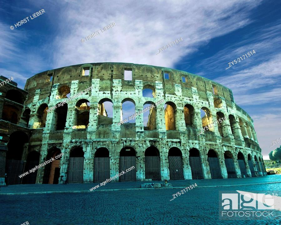 Stock Photo: The Colosseum with clouds and two legionnaires in the foreground, Rome, Italy.