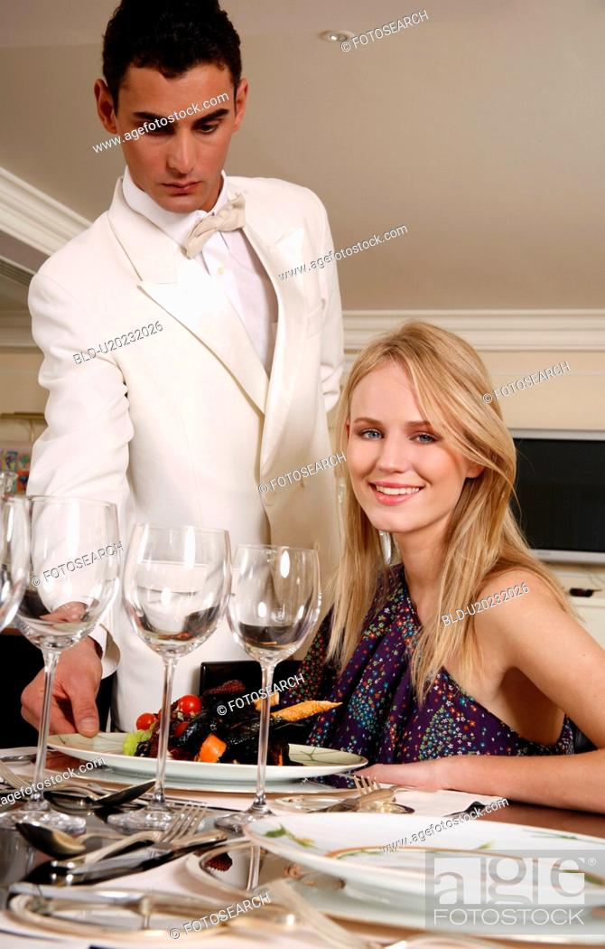 Stock Photo: Hotel waiter serving guest.
