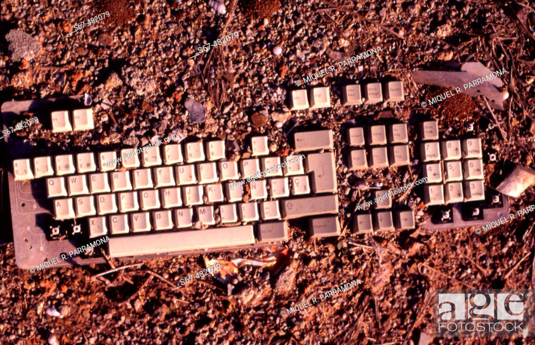 Stock Photo: Computer keyboard half buried in earth. Next to Glorias, Barcelona. Catalonia. Spain.