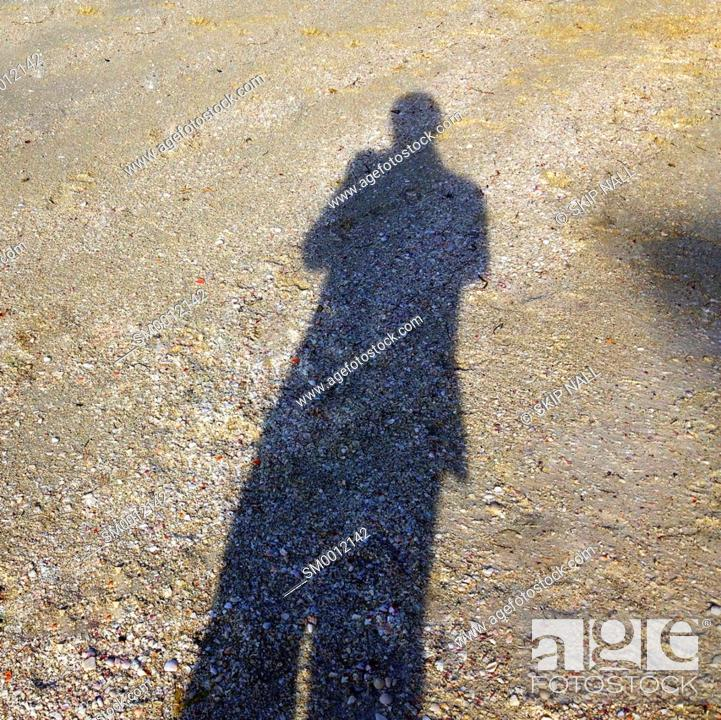 Stock Photo: The shadow of a person on the sand at the beach.