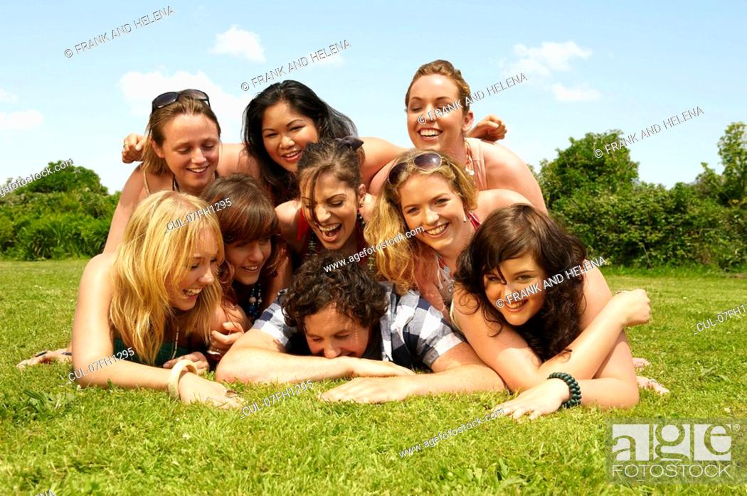 Stock Photo: Portrait of a group young people on lawn.