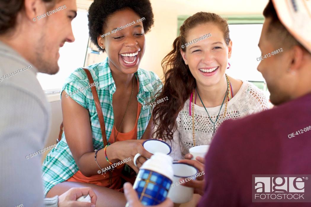 Stock Photo: Friends drinking tea in van.