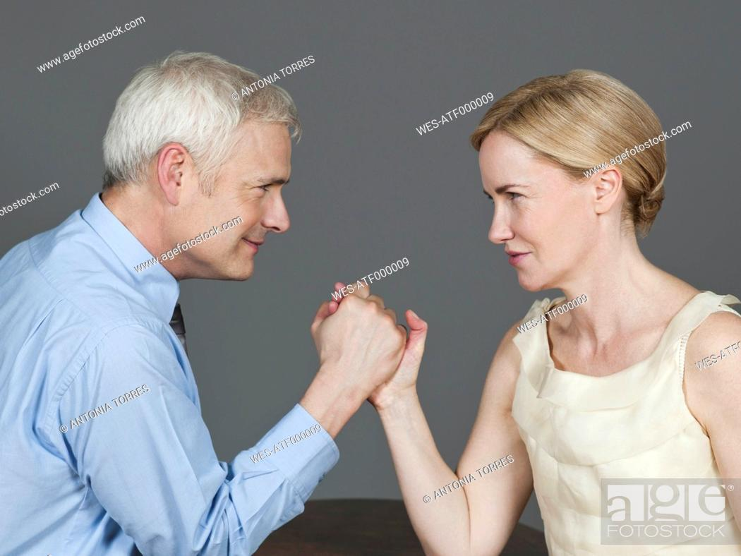 Stock Photo: Mature couple arm wrestling.