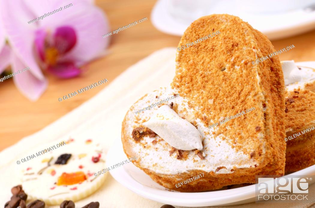 Stock Photo: Heart shaped cake with coffee cup aside.