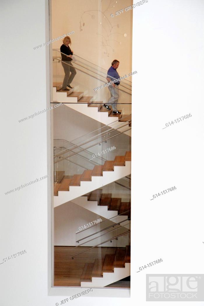 Stock Photo: New York, New York City, NYC, Midtown, Manhattan, 53rd Street, The Museum of Modern Art, MoMA, building interior, stairs, design, architecture, man, woman.