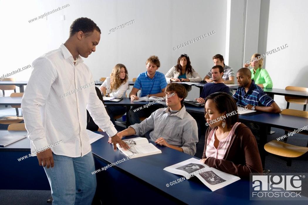 Stock Photo: Teacher teaching students in the classroom.