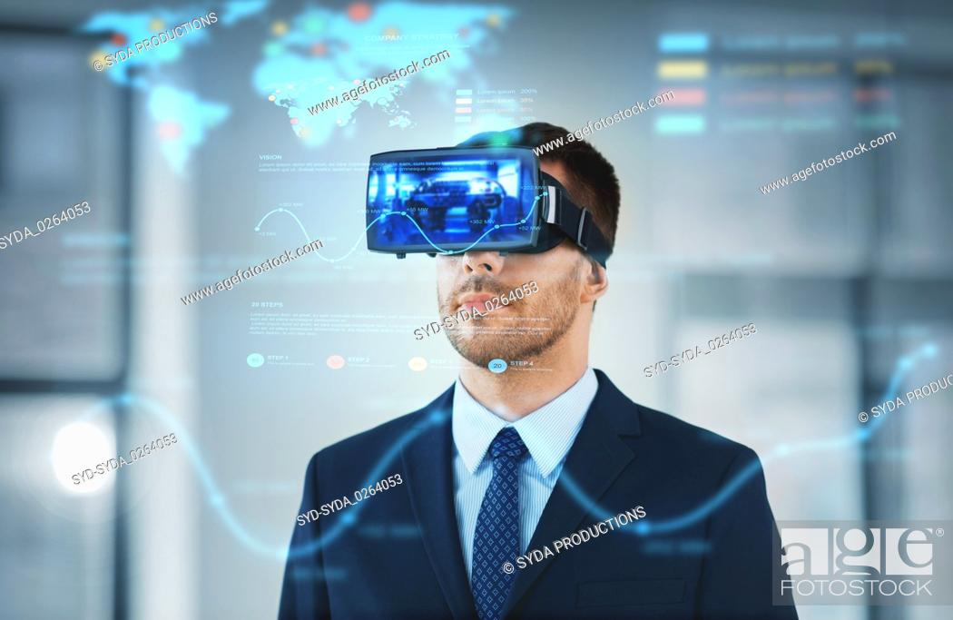 Stock Photo: businessman with virtual reality headset at office.