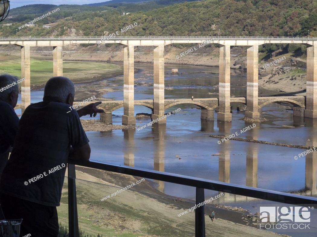 Stock Photo: Portomarin, Lugo. The low water level due to the drought allows to see some ruins of the old town flooded in the 60s, when the Belesar reservoir was built.