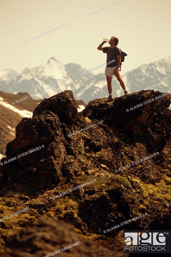 Stock Photo: Hiker on Ridge Chugach Mts Summer SC AK.
