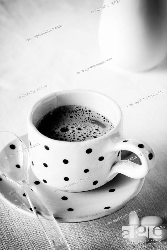 Photo de stock: Cup of coffee and sugar.